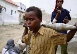 Somali child holds ammunition as fighters loyal to Hisbul Islam party