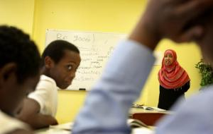 Ardo Mohamed (right) quizzed students, including Burhan Ali (left), on Somali vocabulary words during a recent class