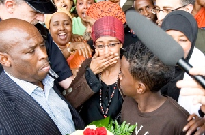 Suaad Hagi Mohamud, centre, her ex-husband Hussein Asbscir, bottom left, and their 12-year-old son Mohamed Hussein, right