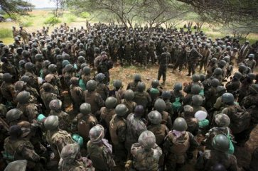 African Union Mission in Somalia (AMISOM) Contingent Commander for Uganda, Brigadier Paul Lokech (centre), briefs members of 09 Battalion before an advance on the town of Afgoye