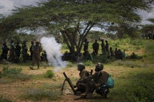 Ugandan soldiers serving with the African Union Mission in Somalia (AMISOM) fire a mortar near the outskirts of the town of Afgoye