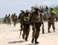 African Union Mission in Somalia troops patrol after fighting against Islamist insurgents al Shabaab in Mogadishu
