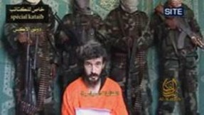 Frame grab of French hostage Dennis Allex reading a statement