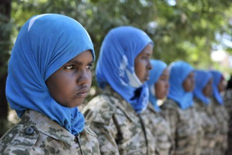 Female Somali National Army (SNA) soldiers stand to attention at a training camp, where they are instructed by the Djiboutian contingent of the African Union Mission in Somalia (AMISOM), in Belet Weyne , about 315 km (196 miles) from the capital Mogadishu, February 19, 2013, in this picture provided by the African Union-United Nations Information Support (AU-UN IST) team. According to the AU-UN IST, the city, which is Somalia's fifth largest, was first liberated from the extremist group al Shabab in September 2011 by Ethiopian troops, but was taken over by the Djiboutian contingent of the AMISOM in September 2012.