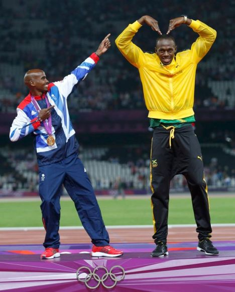 Jamaicas-Usain-Bolt-R-celebrates-with-Britains-Mo-Farah-on-the-podium-2256827