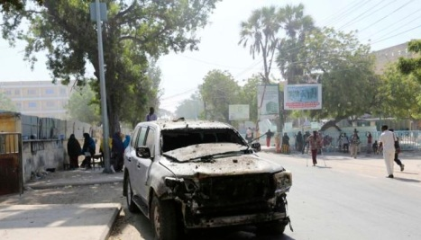 The wreckage of a car destroyed in a blast is seen near the Central Hotel after a suicide attack in Mogadishu