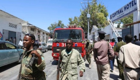 Somali security agents are seen outside the Central Hotel after a suicide attack in Mogadishu