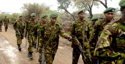 Kenyan military personnel march to Camp Great White to participate in the opening ceremony for exercise Natural Fire 2006 conducted at Nginyang Village, Kenya, Aug. 7, 2006. The exercise, the largest held between East African Community nations and the United States, consists of military-to-military training as well as medical, veterinary, and engineering civic affairs programs conducted in rural areas throughout the region. (U.S. Air Force photo by Staff Sgt. Nic Raven) (Released)