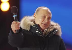 Vladimir Putin supporters celebrate Putin's victory